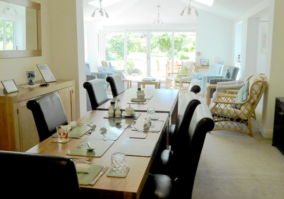 Communal dining room at Abbeyfield House where the residents come together to share meals