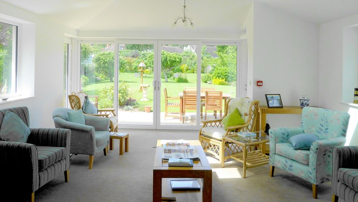 Communal lounge overlooking the lovely garden where residents can enjoy the views and socialise with other residents